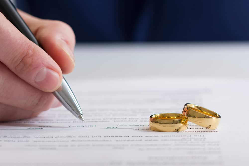 2 wedding rings on document