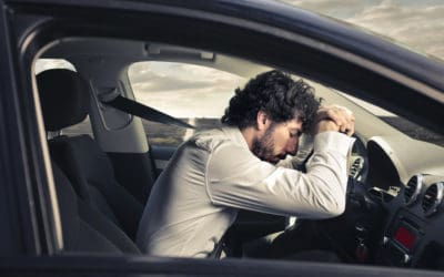Man fatigued and tired while driving