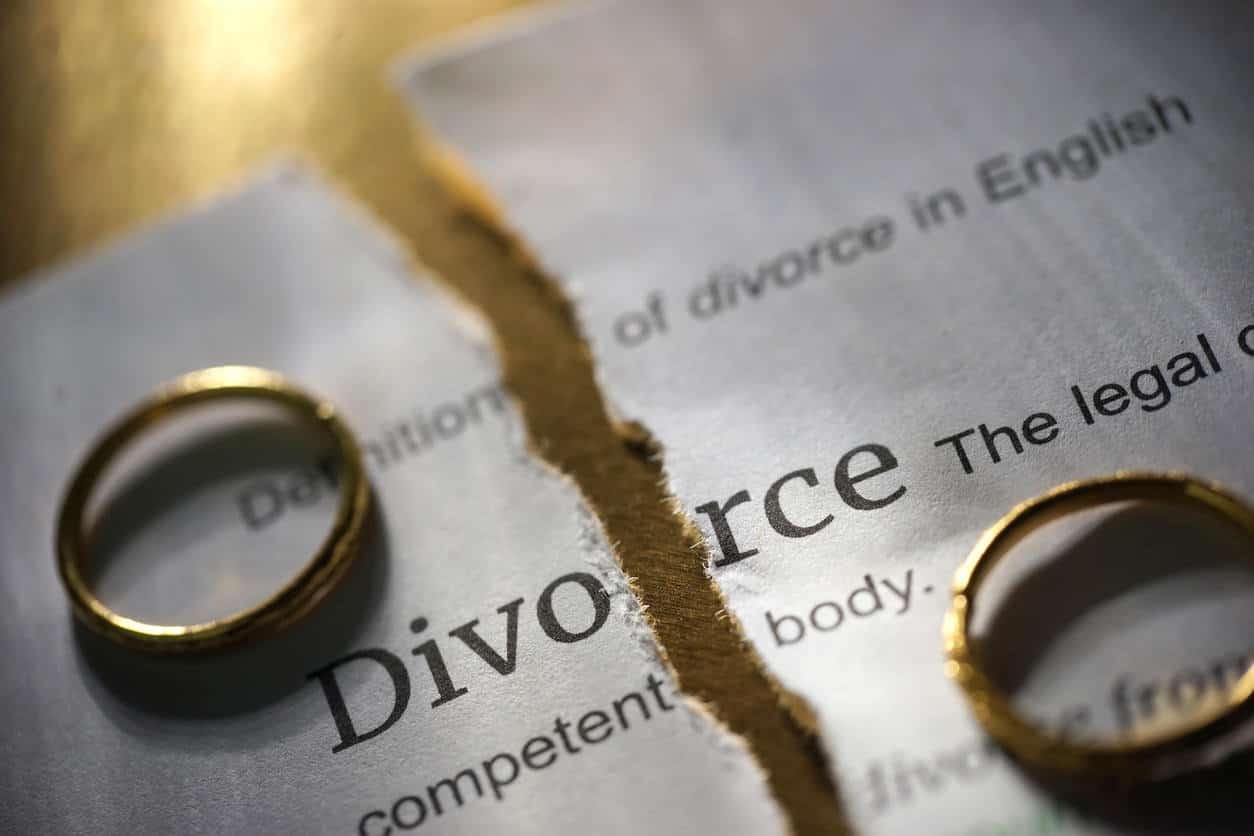 Divorce document torn up and wedding rings apart