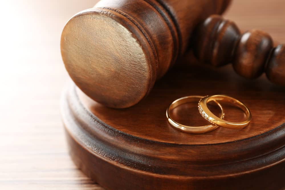 Gavel with two wedding rings
