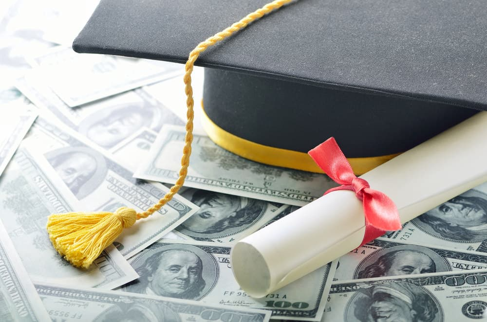 Student loan photo with diploma and cash