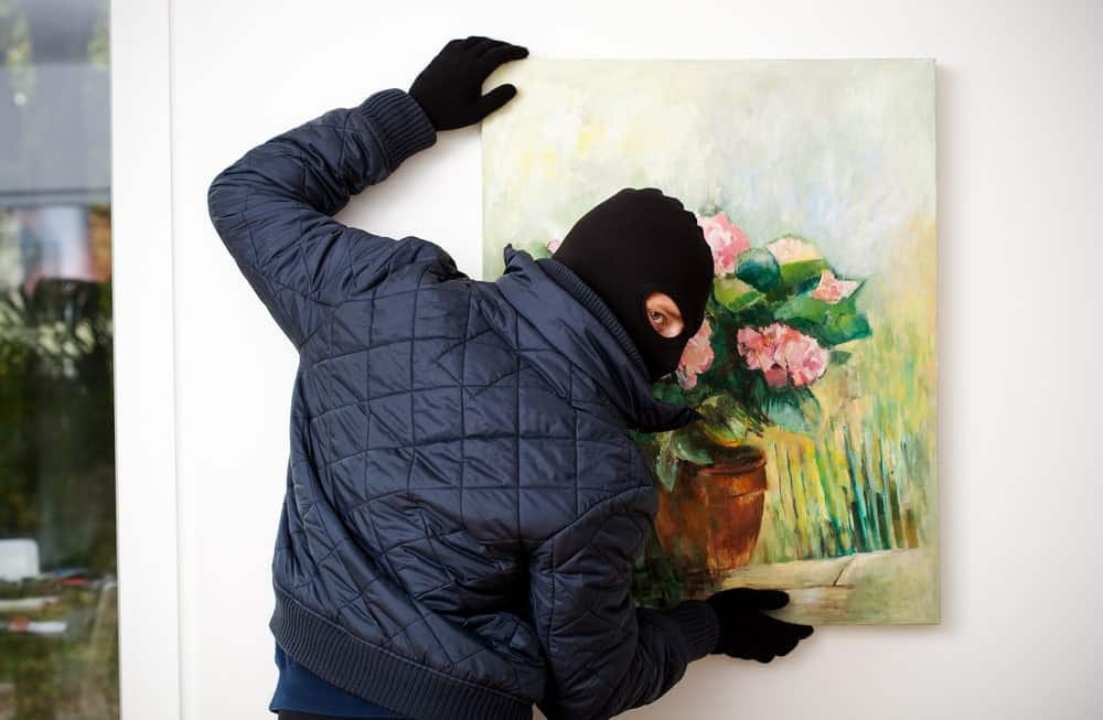 Man stealing a painting