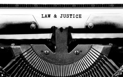 Lawyer writing blog post on typewriter