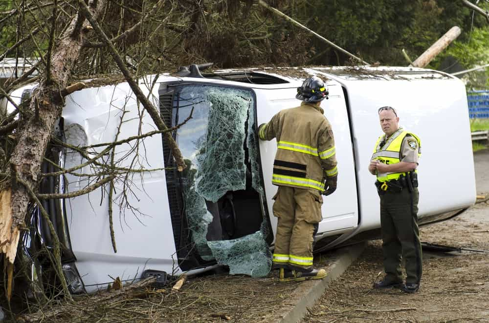 Authorities inspecting a single-car accident.