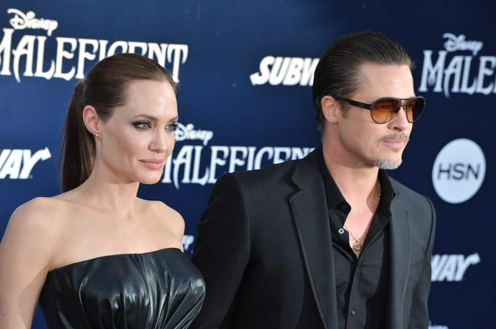 Brad Pit and Angelina Jolie sport dark outfits for Maleficent premiere