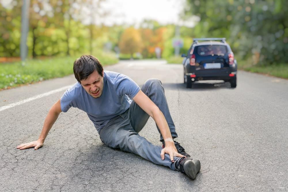 Car drives away after hitting a pedestrian