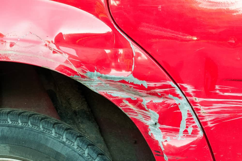 A red car post collision