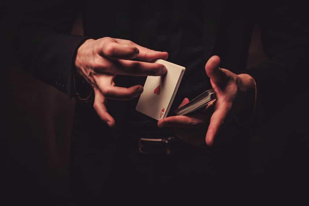 Magician holding a stack of cards.