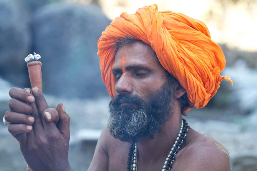Holy man smokes in India