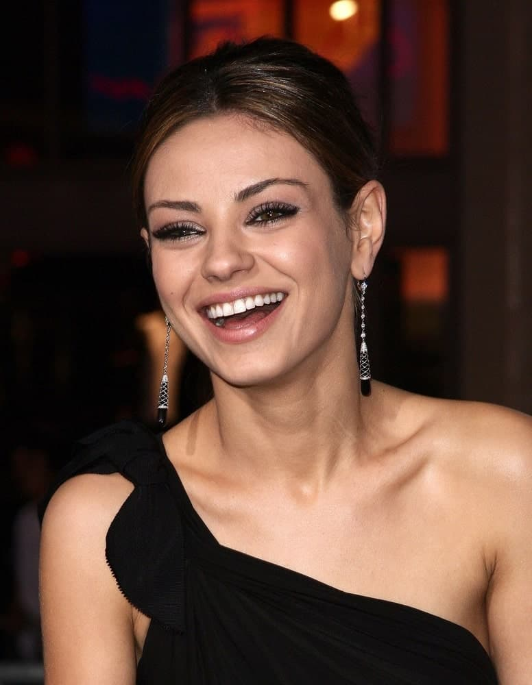 Mila Kunis looking happy