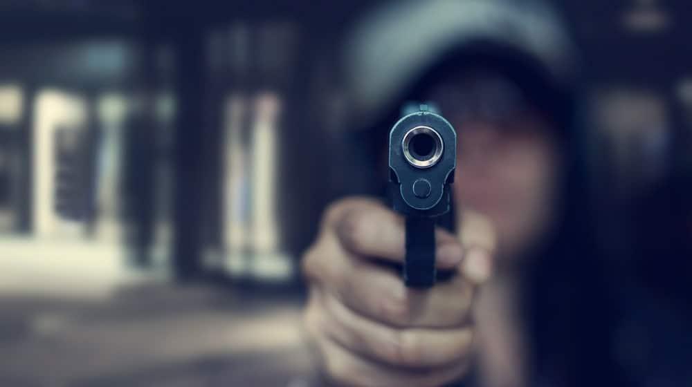 Closeup of a gun being held at.