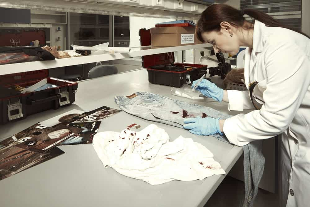A crime scene technician at work